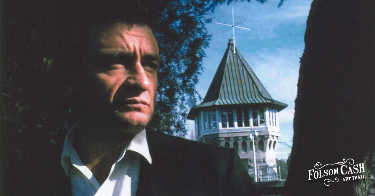 Johnny Cash Pictured in With Folsom Prison in Background